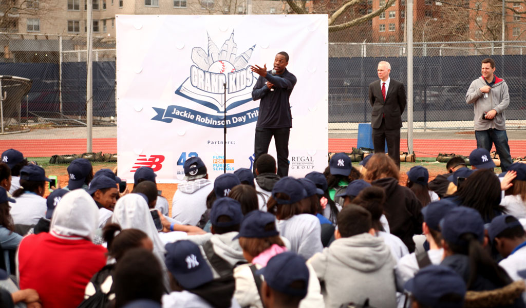2013 - GRAND KIDS RAISES $1 MILLION DOLLARS to rebuild all lost athletic fields at a high school in Brooklyn. They unveil the fields on Jackie Robinson Day, in honor of #42.